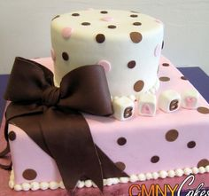 round cake on a square cake, bow to the side, and fondant blocks that say Baby.  Maybe do them in the babies name.