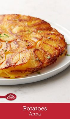 This stunning potato side dish is an updated classic that's guaranteed to steal the show at your next gathering! Thinly sliced potatoes are layered with garlic-and-thyme butter and a sprinkle of Parmesan for an extra boost of flavor that can't be beat. Potatoes Anna, Canned Potatoes, Crispy Potatoes, Sliced Potatoes, French Potatoes, Potato Sides, Potato Side Dishes, Side Dishes For Meatloaf, Betty Crocker