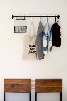 Forget the giant coat rack that always topples over. This horizontal option takes up zero floor space, but offers the same amount of storage. Oh, and did we mention the basket is the perfect spot to drop your keys so you never lose them? Click for more IKEA hacks that will seriously upgrade your entryway.