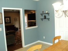 Kitchen is off the Family Room. The White door on the right, heads to the SEPARATE UTILITY ROOM.