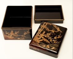 4477 Japanese lacquer box with inner tray. Design of crane, bamboo, plum and turtles in gold on black lacquer, 19th century.
