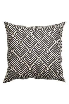 Poszewka na poduszkę we wzory: Poszewka na poduszkę z bawełnianej tkaniny. Wzorzysty przód, jednolity tył. Kryty suwak.