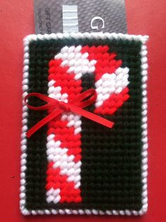 Candy Cane Gift Card Holder, Candy cane, Holiday gifts, Gifts for him, Gifts for… Plastic Canvas Stitches, Plastic Canvas Coasters, Plastic Canvas Ornaments, Plastic Canvas Christmas, Plastic Canvas Crafts, Plastic Canvas Patterns, Gift Cards Money, Christmas Gift Card Holders, Card Factory