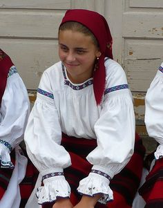 Girl from Sacel, Maramures, Romania wearing an old traditional costume