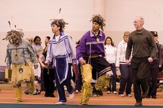 Professor Chris Vecsey (right) joins the Haudenosaunee Singers and Dancers in the Snake Dance at the 2008 Native American Arts and Culture Festival