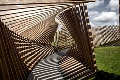 EKKO by Thilo Frank. Visitors to this installation in northern Denmark by German artist Thilo Frank are invited to walk through a contorted loop of timber while listening to the sounds of their voices and footsteps played back to them Timber Structure, Shade Structure, Landscape Structure, Art Et Architecture, Architecture Details, Installation Architecture, Sound Installation, Parametric Design, Land Art