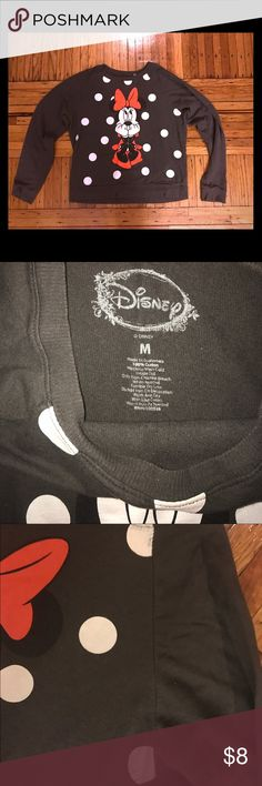 Disney Minnie Mouse Sweater Minnie Mouse Sweater for the Disney lover!  Minnie Mouse Picture is good and super cute!  Sweater itself is in very good condition. Only thing wrong is 2 white polka dots on the left side (one on top and one on the bottom corner) has a little wear as shown in the third pic. Priced accordingly due to that.  Colors are red, gray, and white. Disney Sweaters Crew & Scoop Necks