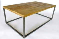 Michaels Coffee Table with a natural wood finish and an industrial metal frame // reclaimed barn wood coffee table