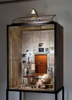 In 'Enclosures' French artist Charles Matton creates meticulous miniature versions of interiors of the studios of Francis Bacon, Rembrandt, Hopper and Giacometti, as well as Baudrillards's library and Freud's study. The atmospheric boxes are painstakingly handmade with intricate details in miniature, including light sockets, furniture and fading wallpaper.