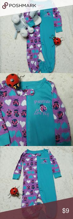 """🐞 Lil' Love Bug Footie 💙 Very gently loved! 💜 Turquoise & purple, zip-up w/button clap & elastic ankle/snug-fitted footie! 🐞 Print is hot pink ladybugs with white and turquoise hearts and says """"grandma's lil Love Bug""""! Love love love this, you definitely will too! 💜  💕Bundle & Save Even More! 🤗 One Pieces Footies"""