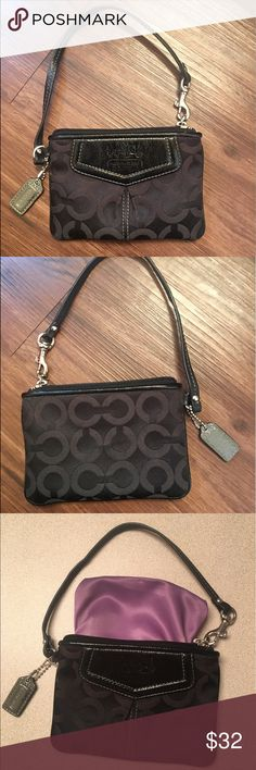 Coach wristlet Black coach wristlet in excellent used condition!  Small scuff on the gray coach tag (see last picture). Coach Bags Clutches & Wristlets