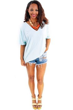 Vivian Piko Tee in Mint Blue - It's your favorite piko brand tee now in a summer fit. A v-neck front and v-neck back give a causal chic flair to an otherwise simple tee. Made of the same slinky and soft material this tee is not only comfortable but cool and lightweight as well. A wide bodice and the extended shoulder hem give a slouchy and urban vibe. Great paired with denim, linen, and any type of short for a cool and casual summer look.  - available online at http://w