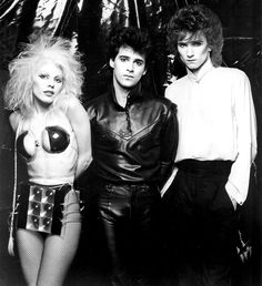 Missing Persons, was an American band that played a blend of New Wave and pop rock music. The band was founded in 1980 in Los Angeles by guitarist Warren Cuccurullo (center), vocalist Dale Bozzio (left) and drummer Terry Bozzio (right). They went on to add bassist Patrick O'Hearn and keyboardist Chuck Wild.