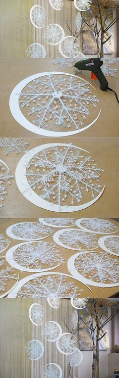 Paper moons and plastic snowflakes with tinsel layered between two to create dimension.