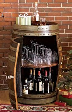 Wine barrel bar table and many other DIY furniture made from wooden barrels . build your own wooden barrel diy furniture wine glasses storage space wine bottles More ideas like this project @ co. Barrel Projects, Diy Projects, At Home Projects, Wine Barrel Bar Table, Wine Barrels, Whiskey Barrel Bar, Diy Furniture Making, Furniture Ideas, Furniture Dolly