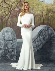 Justin Alexander wedding dresses style 8936 Turn heads with this crepe long sleeve fit and flare gown lined with Jersey from top to bottom. An elaborately beaded motif on the sheer illusion back shows that the beauty is all in the details.