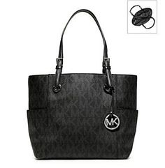 Made with black logo PVC and leather, this classic Jet Set Signature Logo Tote by Michael Kors is versatile and stylish! The double buckled leather straps and logo medallion hanging from the front are crafted from shiny gold-toned metal. The monogram lined interior has two main sections divided by a large zipper compartment. Leather trims the four open pockets and zip pocket.