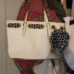 Michael Kors medium satchel White with navy blue polka dotted ribbon looped through gold with a gold MK symbol hanging Michael Kors Bags Shoulder Bags
