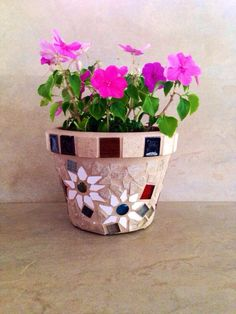 A personal favorite from my Etsy shop https://www.etsy.com/listing/233479794/mosaic-flower-pot-outdoor-planter-indoor