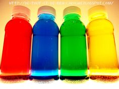 Great activities for Preschool: Bottles of discovery, primary and secondary colors on the light table ...needs to be translated!
