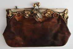 Art Nouveau leather and silver plate purse with cicada clasp.