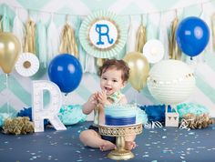 Baby boy posing in blue and white themed Baby Cake Smash Photo by Brandie Narola Photography
