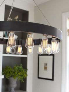 There is something a bit modern about this iron chandelier (which would otherwise be quite rustic) makes it quite versatile don't you agree? :)