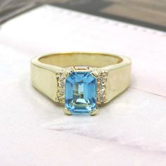 EMERALD CUT BLUE TOPAZ DIAMOND SIDES 14K YELLOW GOLD RING