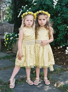 flower girls in gold - photo by Virgil Bunao http://ruffledblog.com/charleston-wedding-with-loads-of-bright-colors
