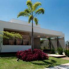Casa Térrea - contemporânea: Casas modernas por Camila Castilho - Arquitetura e Interiores