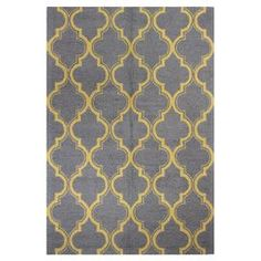 """Bring textured appeal to your living room or master suite with this hand-tufted wool rug, showcasing a classic trellis motif in a chic grey and gold palette.  Product: RugConstruction Material: WoolColor: Grey and goldFeatures:  Hand-tufted0.5"""" Pile heightLoop pile  Note: Please be aware that actual colors may vary from those shown on your screen. Accent rugs may also not show the entire pattern that the corresponding area rugs have.Cleaning and Care: Regular vacuuming and spot cleaning ..."""