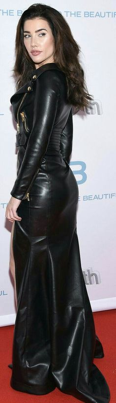Long sleeve leather maxi dress with gold zipper details on red carpet