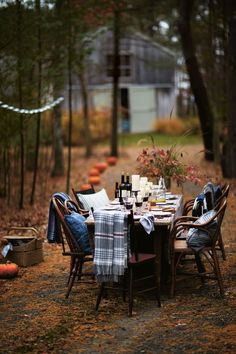 Autumn party in the forest. Love the warm blankets on each chair for a chilly night.