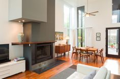 Asymetric column fireplace with built in display nook