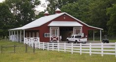 This horse barn was built for Denise of Thompson's Station, TN  Special Features:    Morton's Hi-Rib Steel  Wainscot  Cupolas  Porches  Eyebrow Overha...