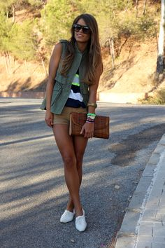 Military vest + striped tee + neutral shorts + white sneakers