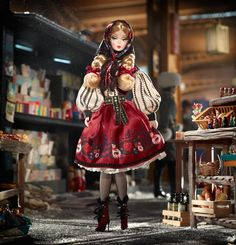Mila Barbie From the Imperial past to the modern present in Russia. Brilliant reds and whimsical matryoshka dolls inspired by traditional folkloric design. Designed by Robert Best, 2011, limited edition 5800 units.