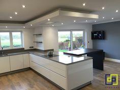 white gloss next 125 kitchen. Gris expo silestone worktops with dekton sirus table