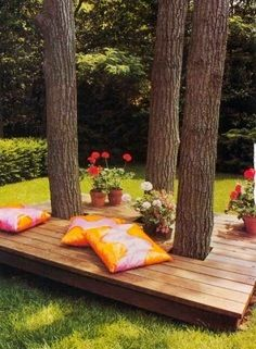 Pallet boards used to create a small deck in your backyard is the perfect way to keep cool year round. Add pillows and potted plants to finish the look.