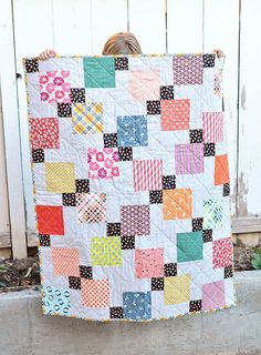 """Nice quilt, baby size (36x45""""), good for favorite fabrics.  Disappearing nine patch by Kitchen Table Quilts."""