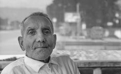 romania people street photography old man sitting in a bar relaxing