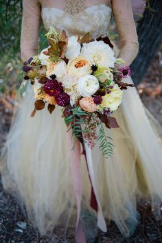 fall bouquet - photo by Brittany Michelle Photography http://ruffledblog.com/fall-wedding-inspiration-with-berries