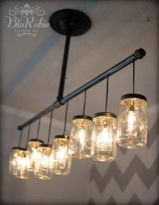Light up the room by putting jars over light bulbs. You – and the room – will feel brighter instantly! For more ways to use jars, check out these mason jar upcycling projects.