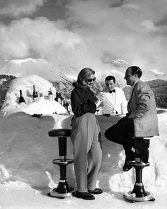 """From a 1947 story on St. Moritz, Switzerland - """"Midday cocktails at St. Moritz are served on the private ice rink of the Palace Hotel at a bar made of snow."""" (Alfred Eisenstaedt—The LIFE Picture Collection/Getty Images) #FashionFriday #1940s #Switzerland"""