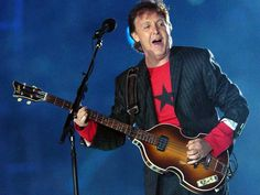 Super Bowl XXXIX (Feb. 6, 2005) | Paul McCartney performs during halftime of Super Bowl XXXIX at Alltel Stadium in Jacksonville, Fla. [no wardrobe malfunction this year!]
