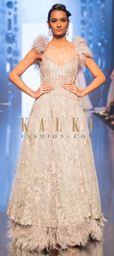 fc81094e3f01 We ship worldwide (Free Shipping over US$100) Click Anywhere to Tag  Aqua-blue-embroidered-net-gown-with-feathers -at-the-strap-and-hem-only-on-Kalki