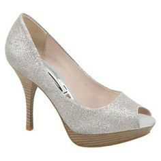 Silver Glitter Heels from VEGAN STYLE. Evening allure with a sexy edge! Stiletto height with platform comfort compliments the cheeky peep toe and dazzling glittery finish. These night time stunners will complete your look and make an enviable impression.    $60
