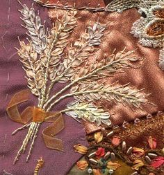 "I ❤ crazy quilting, beading, & ribbon embroidery . . . Wheat- This wheat bouquet was done using silk perle 12 for the stems, 4 mm hand dyed silk ribbon for the wheat heads and Krienik #4 gold braid for the embellishment on the wheat heads. Organza 3/8"" ribbon was tied in a knot then tacked in place. ~By Stephanie Novatski © 2004"