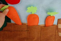 Felt house garden side. I don't know if I would make it all out of felt, but I LOVE the add on activities of the garden - carrots, tomatoes, apples...