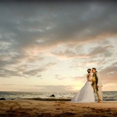 The perfect dramatic beach wedding photo taken in Maui, Hawaii. The ideal Maui wedding shot.